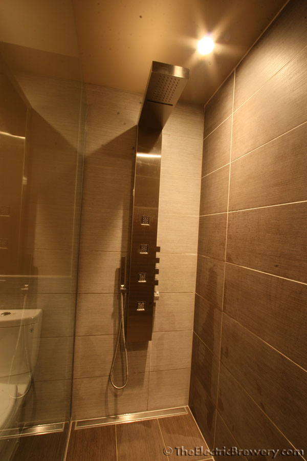 the bathroom vanity lighting mirror and shower tower were installed